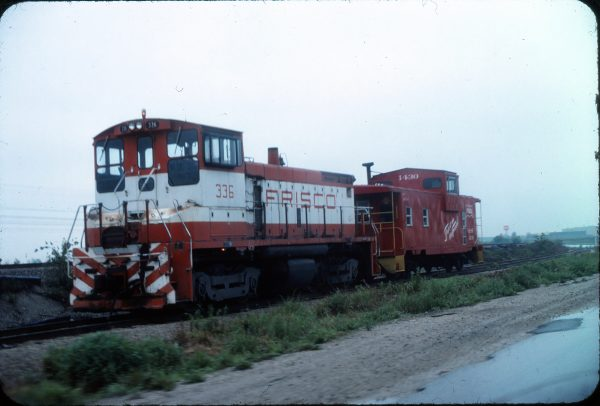SW1500 336 and Caboose 1430 (location unknown) in May 1976