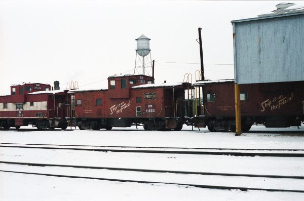 Cabooses 11544 (Frisco 1215) and 11583 (Frisco 1255) at Springfield, Missouri on December 26, 1983 (R.R. Taylor)