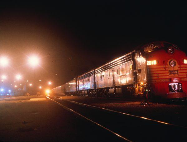 E8A 2018 (Ponder) on Train #9 at Monett, Missouri on August 26, 1965 (Mike Condren)