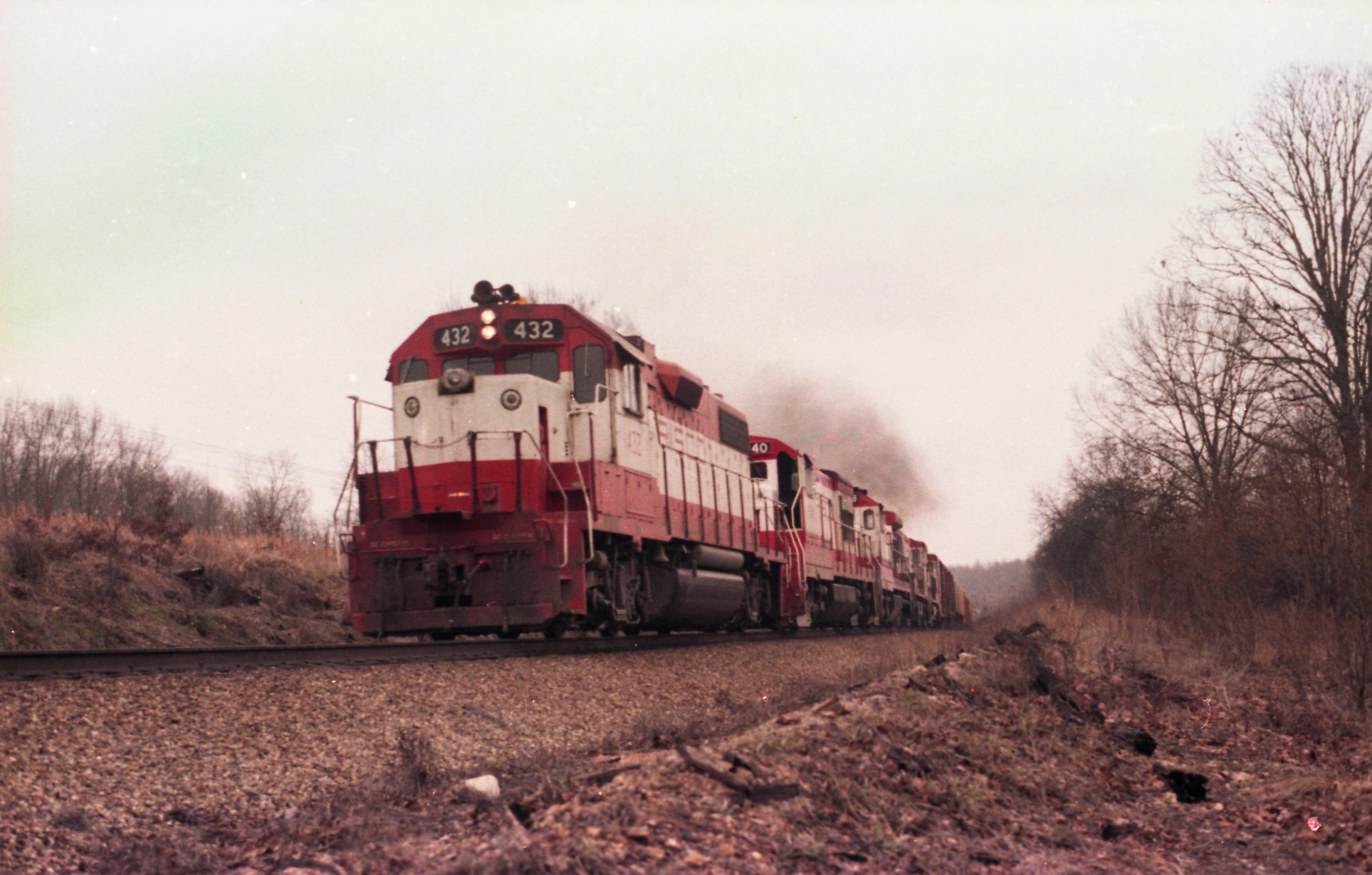 GP38-2 432, U30B 840, B30-7 869, U25B 831, B30-7 865 and Boxcar 47220 North of Thayer, Missouri on December 31, 1979
